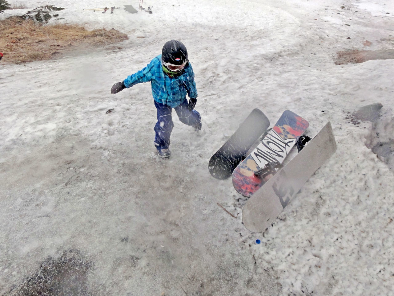 Snowboarding in on slushy snow Adventure Child Cold Day Extreme Sports Fun High Angle View Leisure Activity One Boy Only One Person Outdoors Real People Ski Center Snow Snowboard Snowboarder Snowboarding Winter Winter Sport