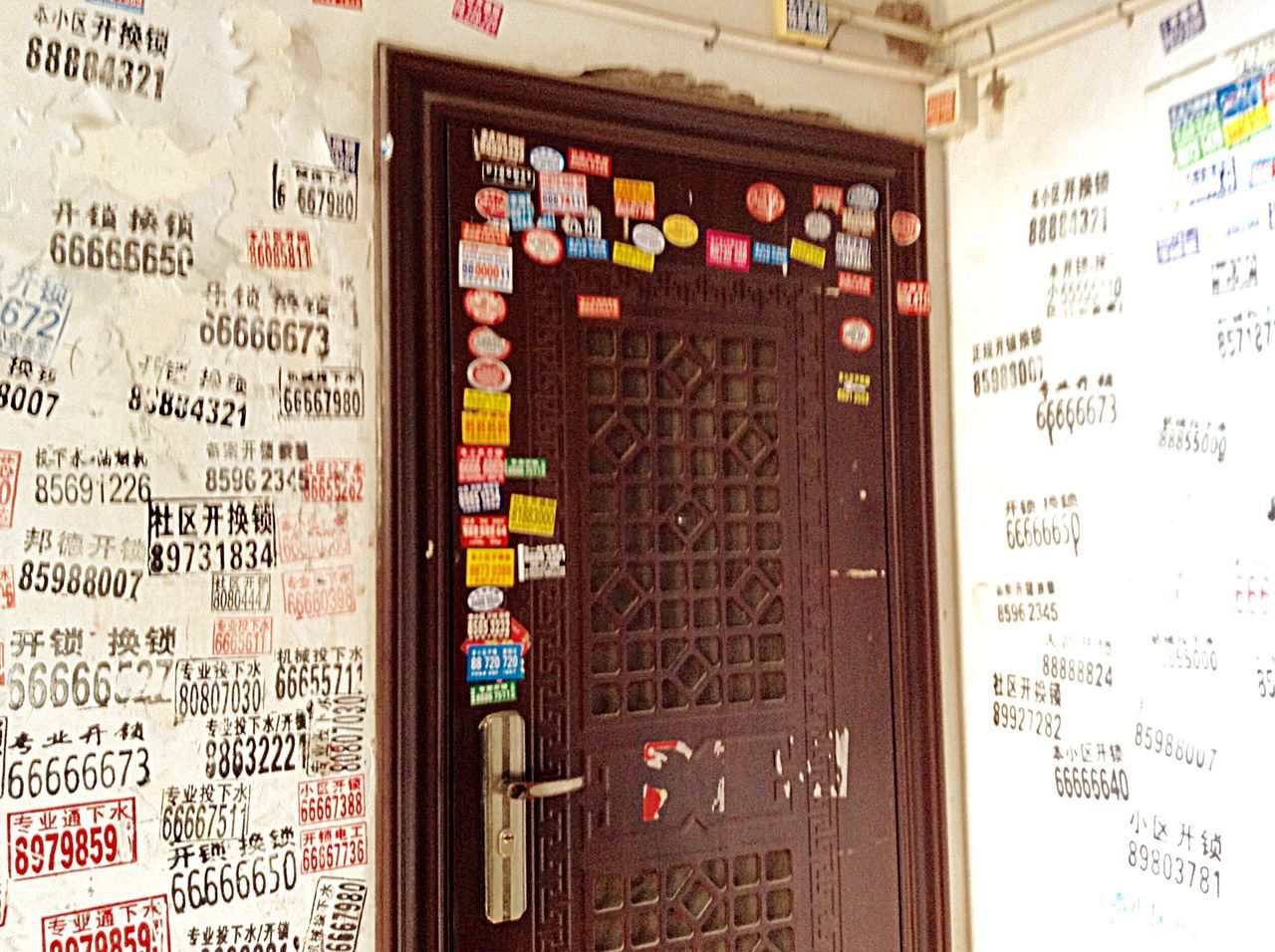 Advertisements all over the wall Advertisement Advertising Ads Wall All Over The Wall Apartment Building Indoor Interior Style Door Entry Door Stairway Travel Qingdao China China Decoration Colour Of Life Culture