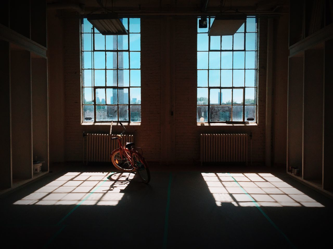 Two Is Better Than One Shadow Light Windows Loft Grid Renovation Bicycle Sunlight Empty Poetry Interior Architecture Toronto Open Edit View Interior Design Shelves Ceiling Pipes Grids Shadows & Lights Interior Views Construction Renovations