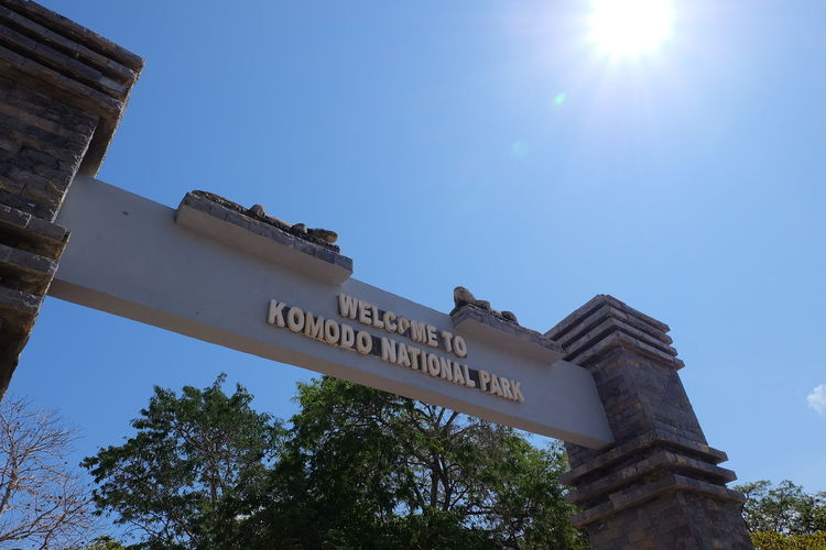 The Gate of Komodo National Park - Indonsesia Gate Komodo Dragon National Park Architecture Building Exterior Built Structure Clear Sky Day Indonesia National Park Komodo Komodo Island Komodo National Park Low Angle View No People Outdoors Sky Sunlight Text Tree