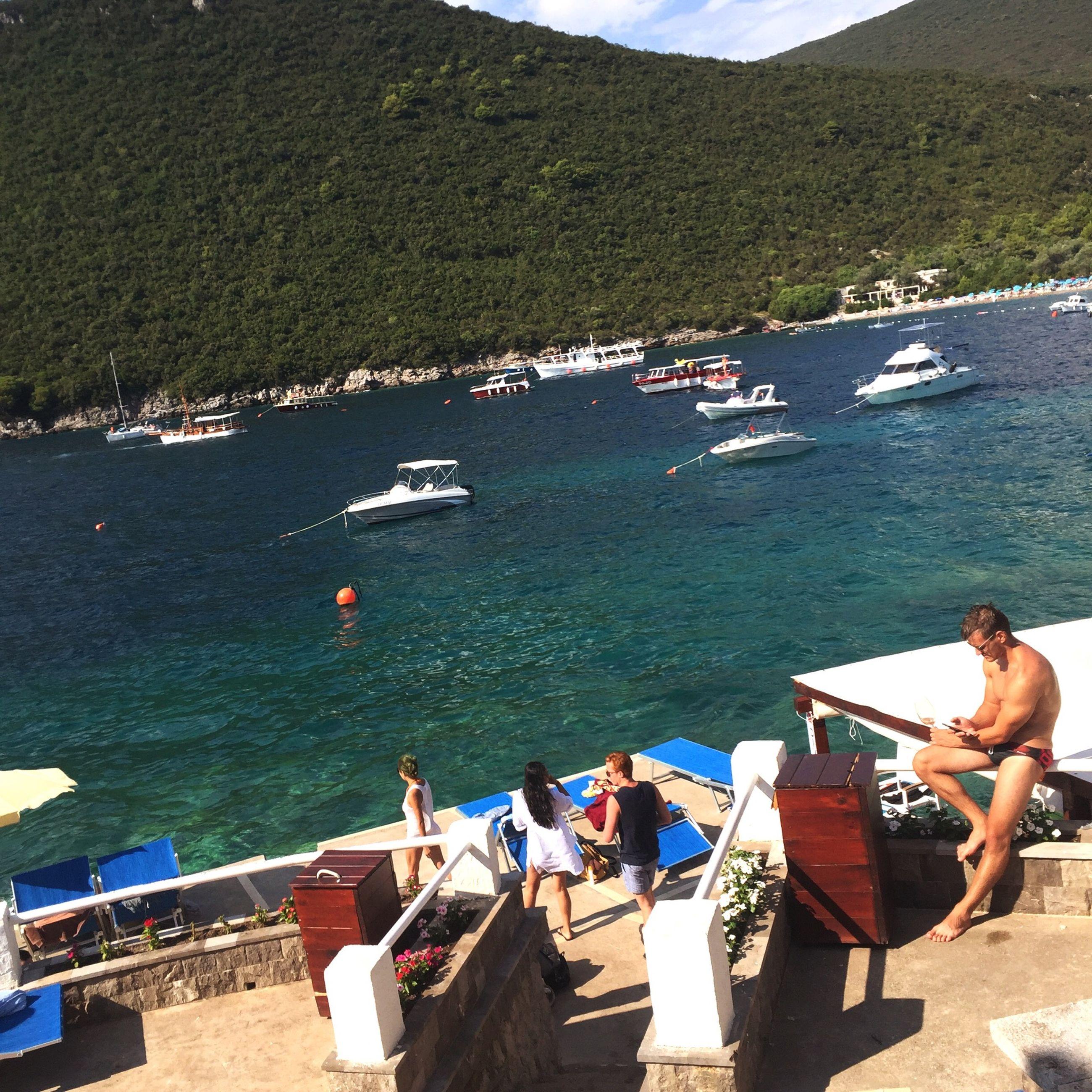 nautical vessel, transportation, boat, water, mode of transport, moored, mountain, ocean, tranquility, tranquil scene, lake, calm, sea, nature, non-urban scene, day, scenics, blue, jetty, outdoors, coastline, solitude, remote, shore, seaside