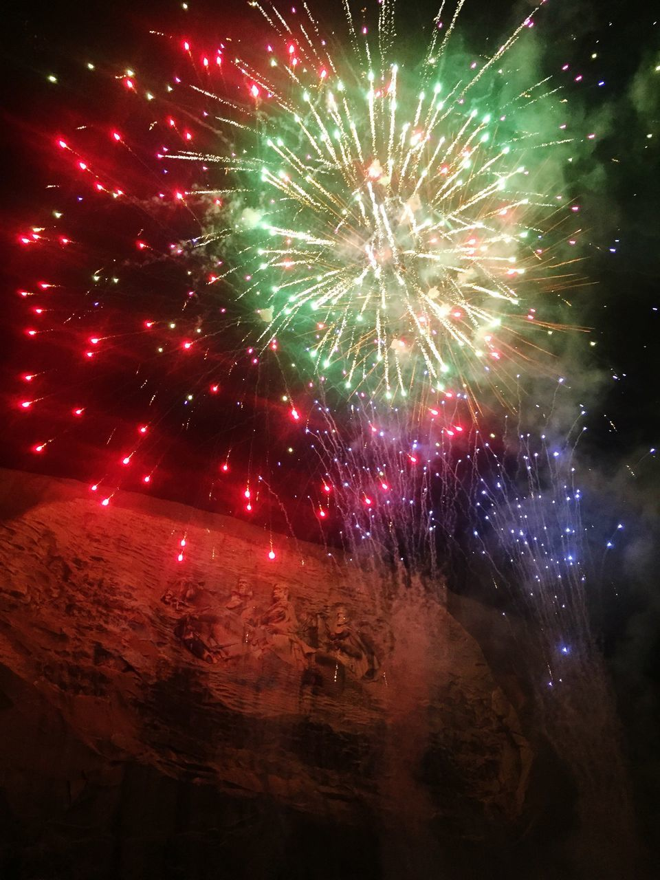 night, exploding, firework display, firework - man made object, celebration, illuminated, low angle view, no people, arts culture and entertainment, red, long exposure, multi colored, outdoors, event, sky, firework