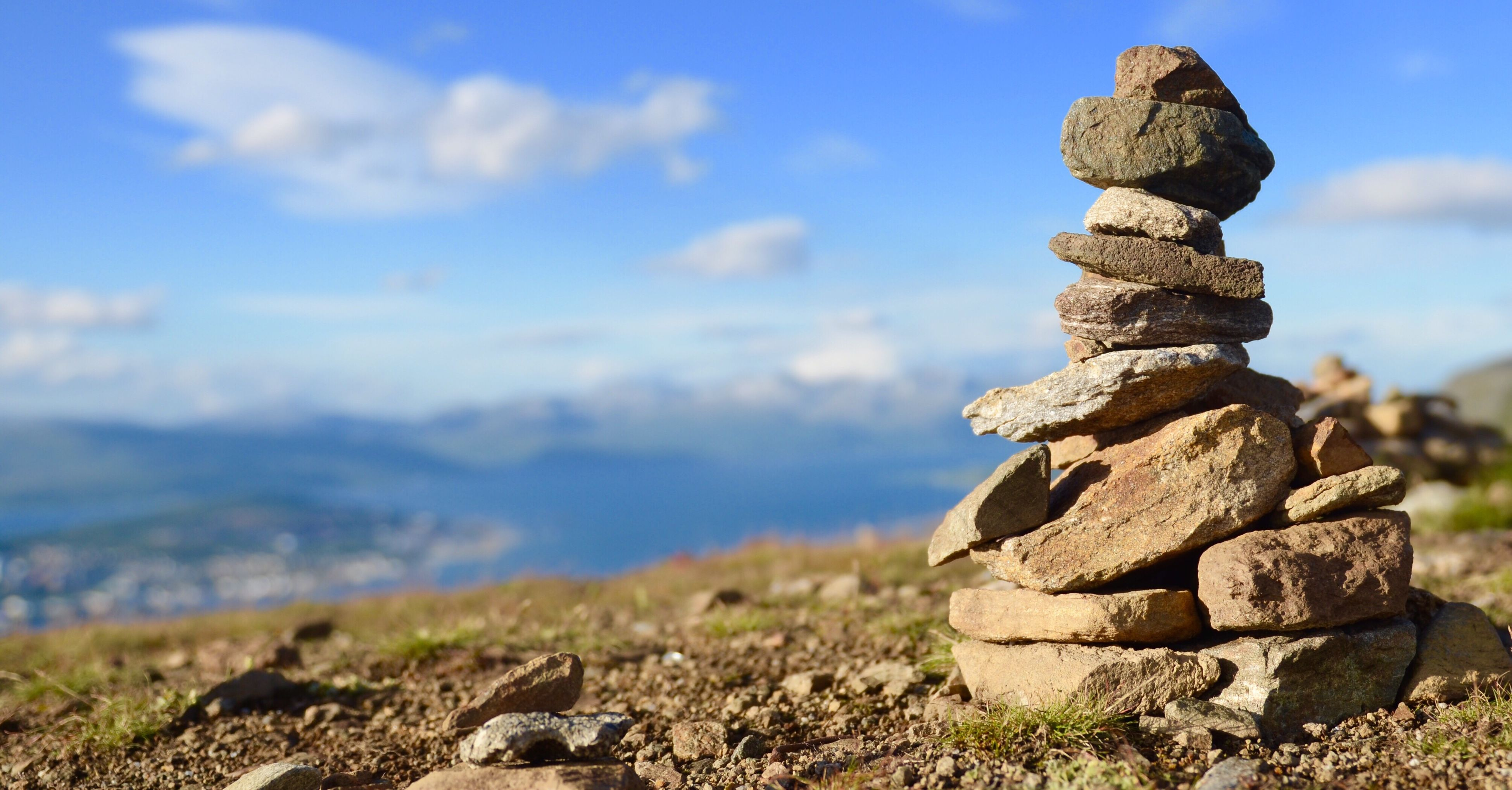 rock - object, day, balance, focus on foreground, stack, outdoors, nature, tranquility, no people, sky, tranquil scene, sunlight, cloud - sky, scenics, beauty in nature, close-up, mountain
