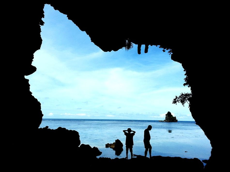 Silhouette Beach Sea Water Sky Outdoors People Scenics Beauty In Nature Sky And Clouds EyeEmNewHere Tranquility Sunny Day Nature Cave Caves Cave Entrance Cave Photography Horizon Over Water Philippines Photos Togetherness Philippines The Philippine Islands The Philippines Let's Go. Together.