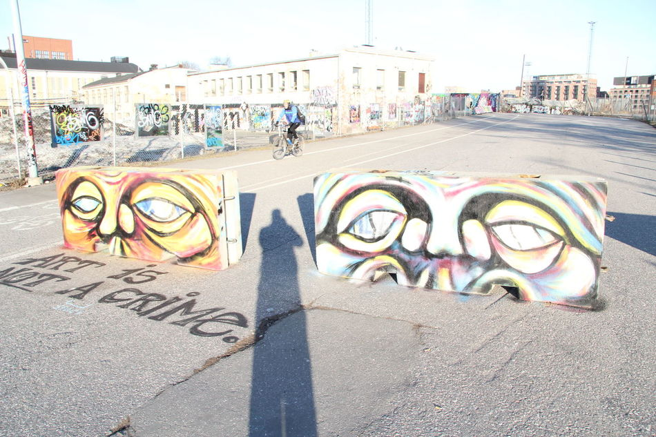 Art Art And Craft City Life Communication Creativity Finland Graffiti Helsinki Human Representation Information Kalasatama Kallio Multi Colored One Person Sidewalk Street Street Art Symbol Sörnäinen Text Wall Wall - Building Feature Western Script