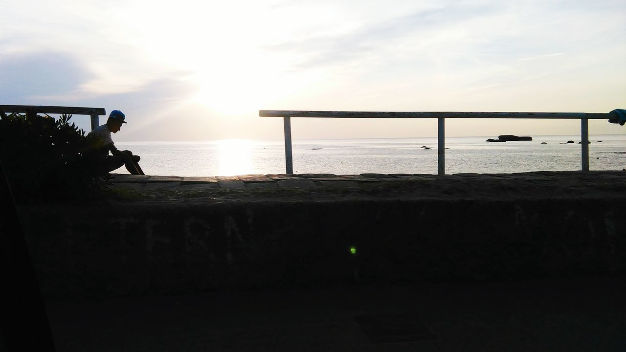 Amazing View Relaxing Hanging Out Sillhouette Sunset Silhouettes Man Sitting Looking Out To Sea. Italy Holidays Ischia Forio
