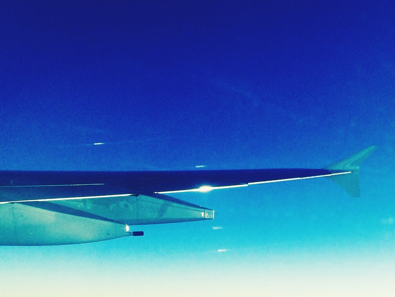 airplane, blue, transportation, no people, air vehicle, outdoors, low angle view, sky, airplane wing, day, clear sky, nature
