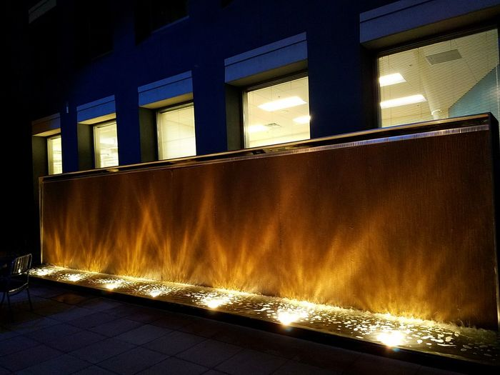 Wall Fountain Illuminated Night Beautifully Structured Gathering Area for people.