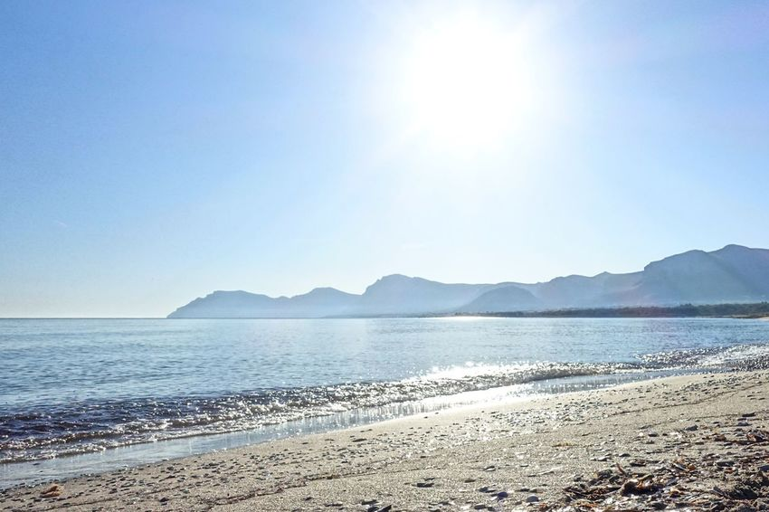 Sea Beach Scenics Nature Sunlight Tranquility Tranquil Scene Water Beauty In Nature Sand Outdoors Lens Flare Horizon Over Water Sun Day Clear Sky No People Mountain Sky Mallorca Son Serra De Marina The Great Outdoors - 2017 EyeEm Awards