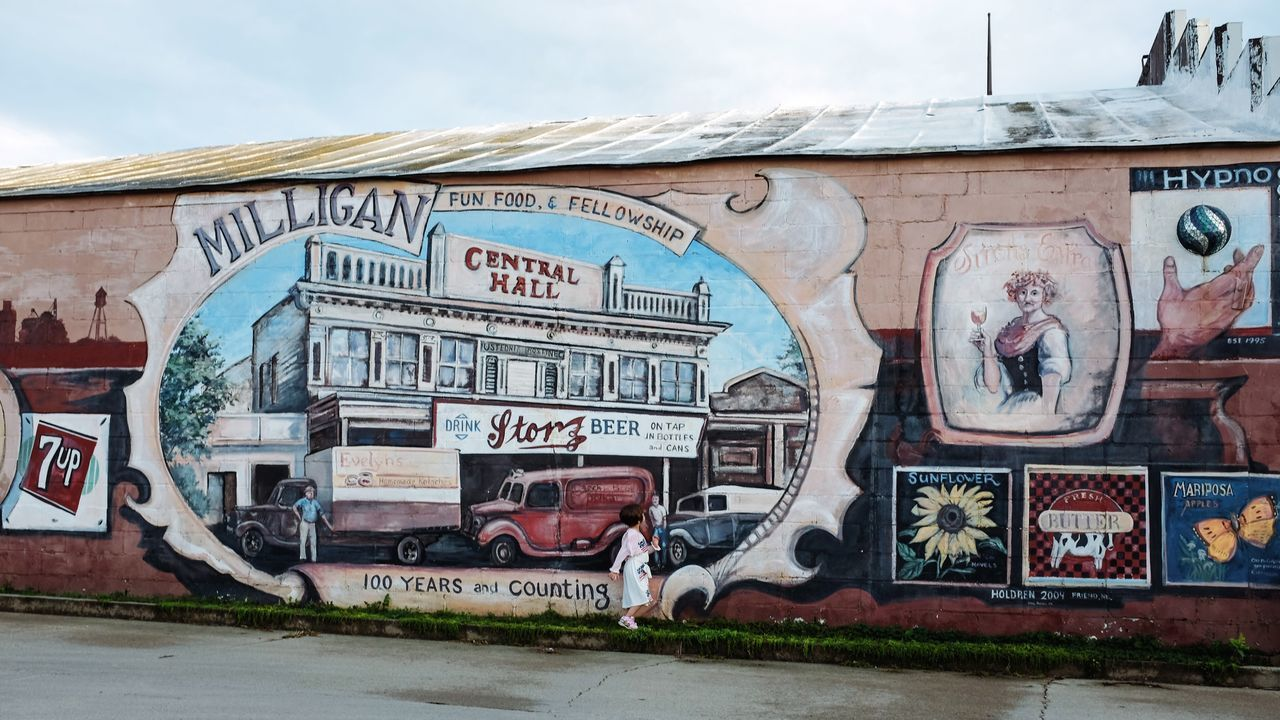 Photo essay, a day in the life. August 24, 2016 Milligan Nebraska 35mm Camera A Day In The Life Architecture Building Exterior Built Structure Camera Work City Cloud - Sky Day Everyday Lives Eye For Photography EyeEm Gallery Eyeemphoto FujiX100S History Mural Art Outdoors Photo Essay Sky Small Town Stories Storytelling Street Streetphotography Text Transportation