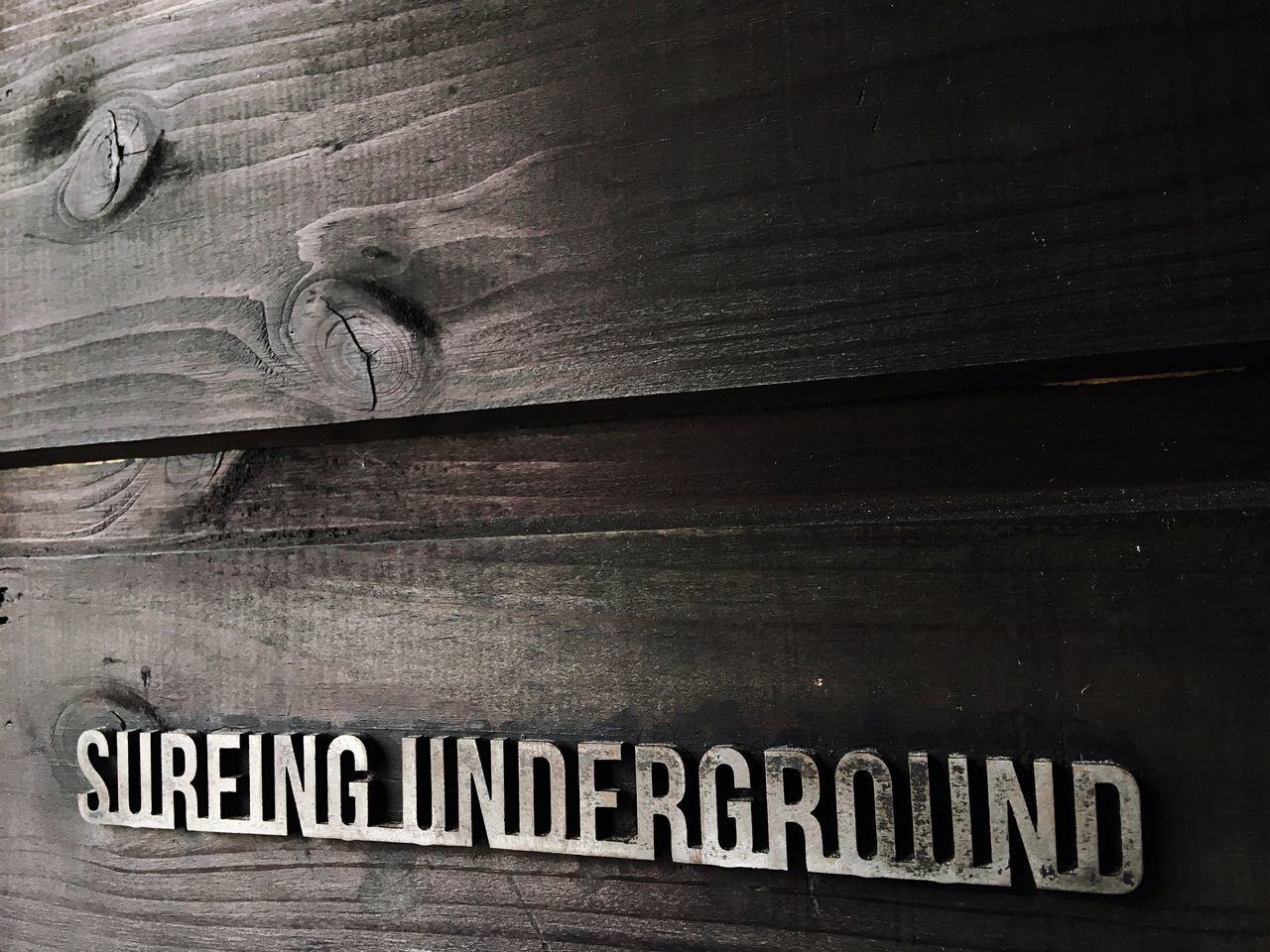 Text Communication Wood - Material No People Indoors  Close-up Backgrounds Built Structure Nameplate Day Suffering Soul Underground Signs Surfing Copy Space Wooden