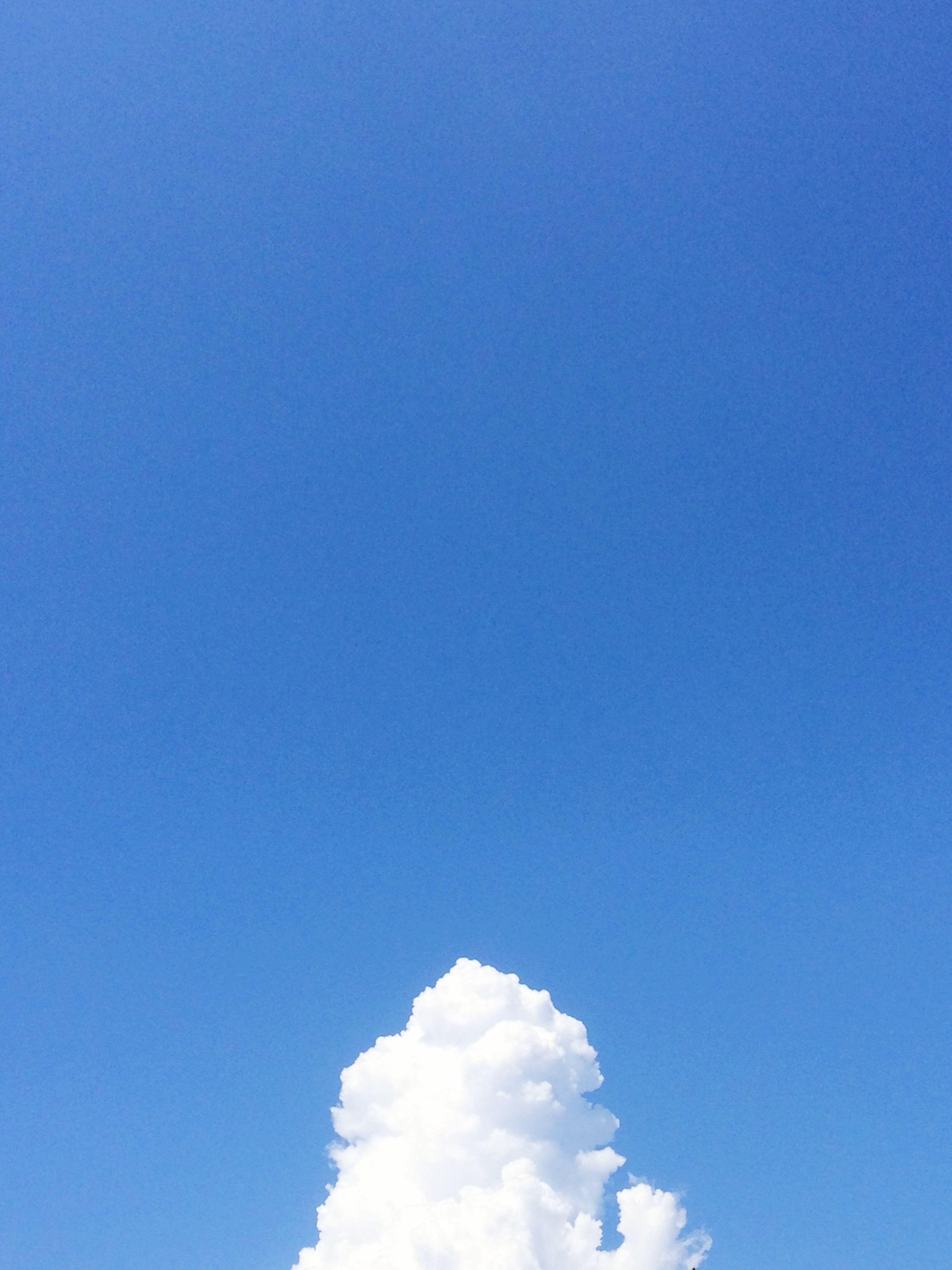 blue, copy space, low angle view, nature, day, no people, sky, outdoors, sky only, beauty in nature, clear sky
