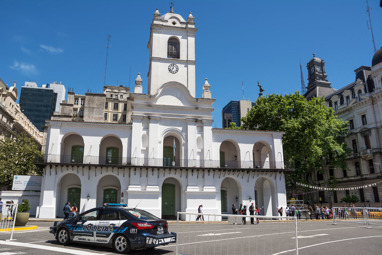 Buenos Aires, Argentina - October 30, 2016: Cabildo of Buenos Aires in a sunday with police car and tourists America Architecture Argentina Argentine Buenos Aires Building Cabildo Capital Car City Ciudad Autónoma De Buenos Aires Colonial Flag Government Historic Landmark Latin Metropolitan Plaza De Mayo Police Square Tourist Tower