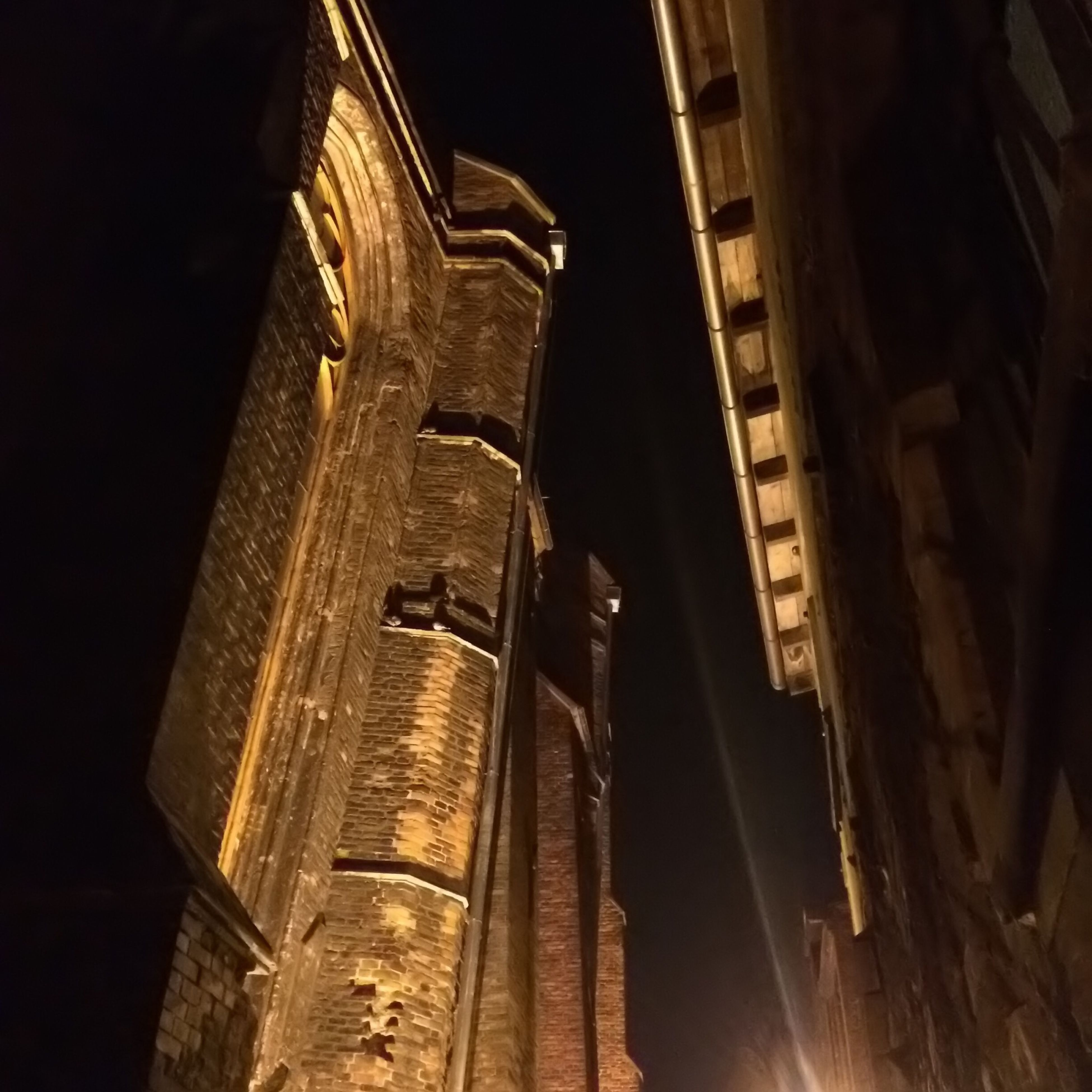 architecture, low angle view, built structure, building exterior, night, illuminated, building, no people, church, outdoors, sky, place of worship, city, window, lighting equipment, clear sky, history, religion, tilt
