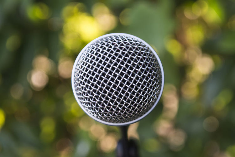 close up of microphone Classic Event Green Color Radio Sound Speech Arts Culture And Entertainment Blurred Background Broadcasting Close-up Communication Conference Entertainment Instrument Karaoke Live Microphone Mike Music Party Performance Sound Recording Equipment Talk Technology Vocal