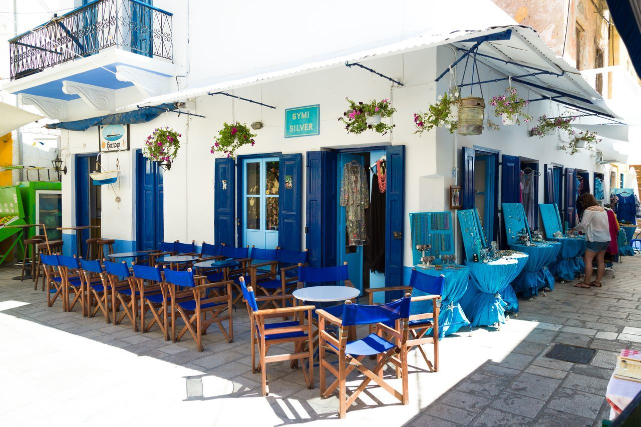 Empty restaurant with no tourists in Symi town, Symi island, Greece Architecture Blue Color Cafe Colorful Dodecanese Empty Family Vacation Greece Greek Islands Lunch Lunch Time Nature Nature_collection Perfect Restaurant Summer Summer Holidays Sunny Symi  Symi Town Symi ısland Travel Travel Destinations Yacht Yacht Destination