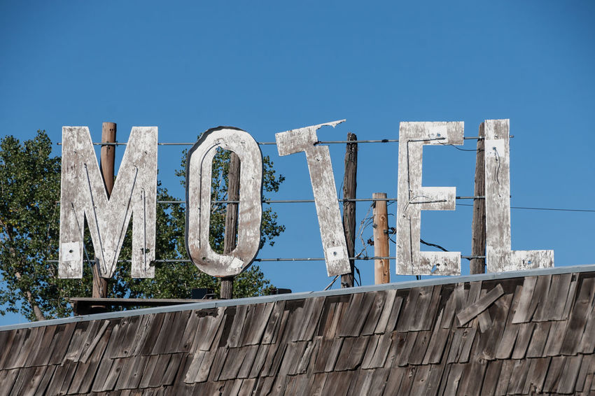 I wouldn't want to stay here Bates Blue Built Structure Clear Sky Crooked Crooked Letters Day Derelict Faded Information Information Sign Letters Motel Motel Sign No People Old Old Buildings Outdoors Peeling Run Down Sign Sky Sunny Type USA