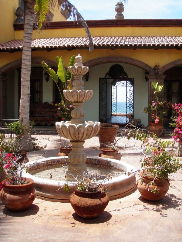 Architecture Balcony Building Exterior Built Structure Chinese Script Courtyard  Culture Cultures Day Decorative Urn Flower Pot Growth Houseplant Incense Place Of Worship Plant Potted Plant Religion Residential Structure Roof Shadow Spirituality Sunlight Tradition Window