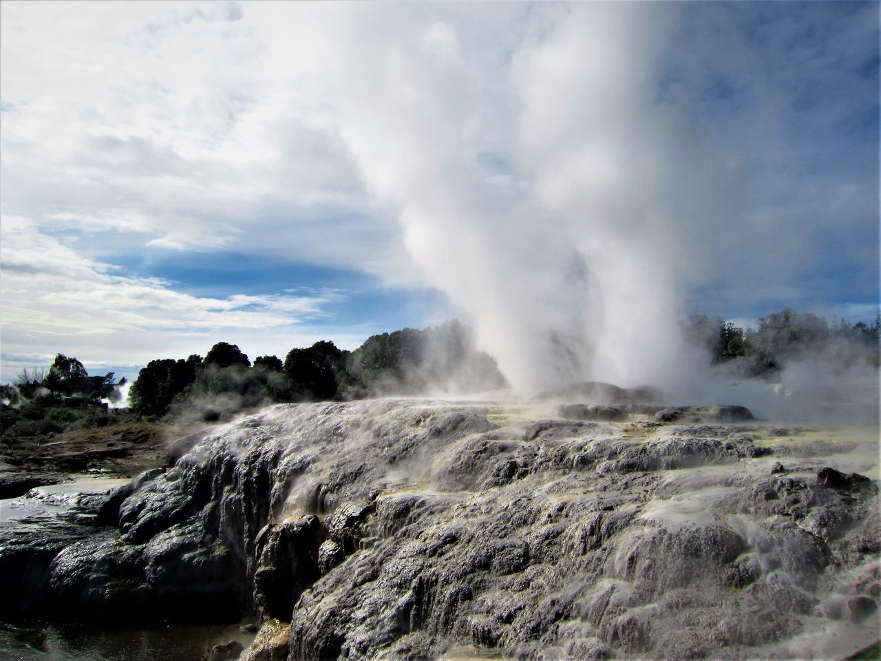 nature, geology, beauty in nature, physical geography, power in nature, scenics, geyser, rock - object, smoke - physical structure, day, landscape, sky, no people, heat - temperature, steam, outdoors, erupting, hot spring, volcanic landscape, tranquility, water