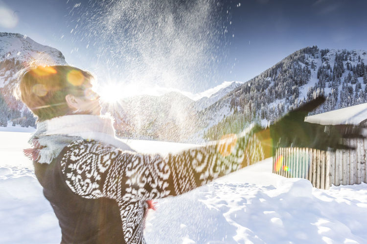 Woman enjoying winter landscape Allgäu Having Fun Hiking Holiday Recreation  Tannheimer Tal Tirol  Woman Bayern Beauty In Nature Bliss Hotel Joy Leisure Activity Lifestyles Mountain Range One Person Outdoors Snow Splashing Sunlight Vacations Vilsalpsee Warm Clothing Winter