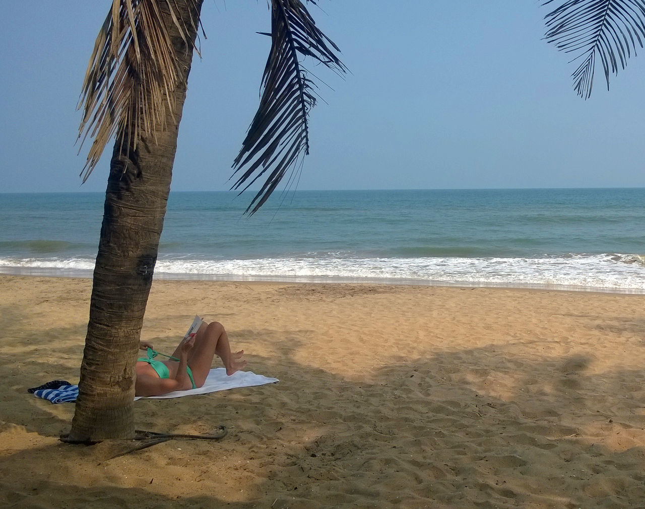 sea, beach, sand, horizon over water, nature, shore, water, vacations, low section, one person, real people, beauty in nature, scenics, outdoors, day, barefoot, sky, relaxation, clear sky, tree, wave, people
