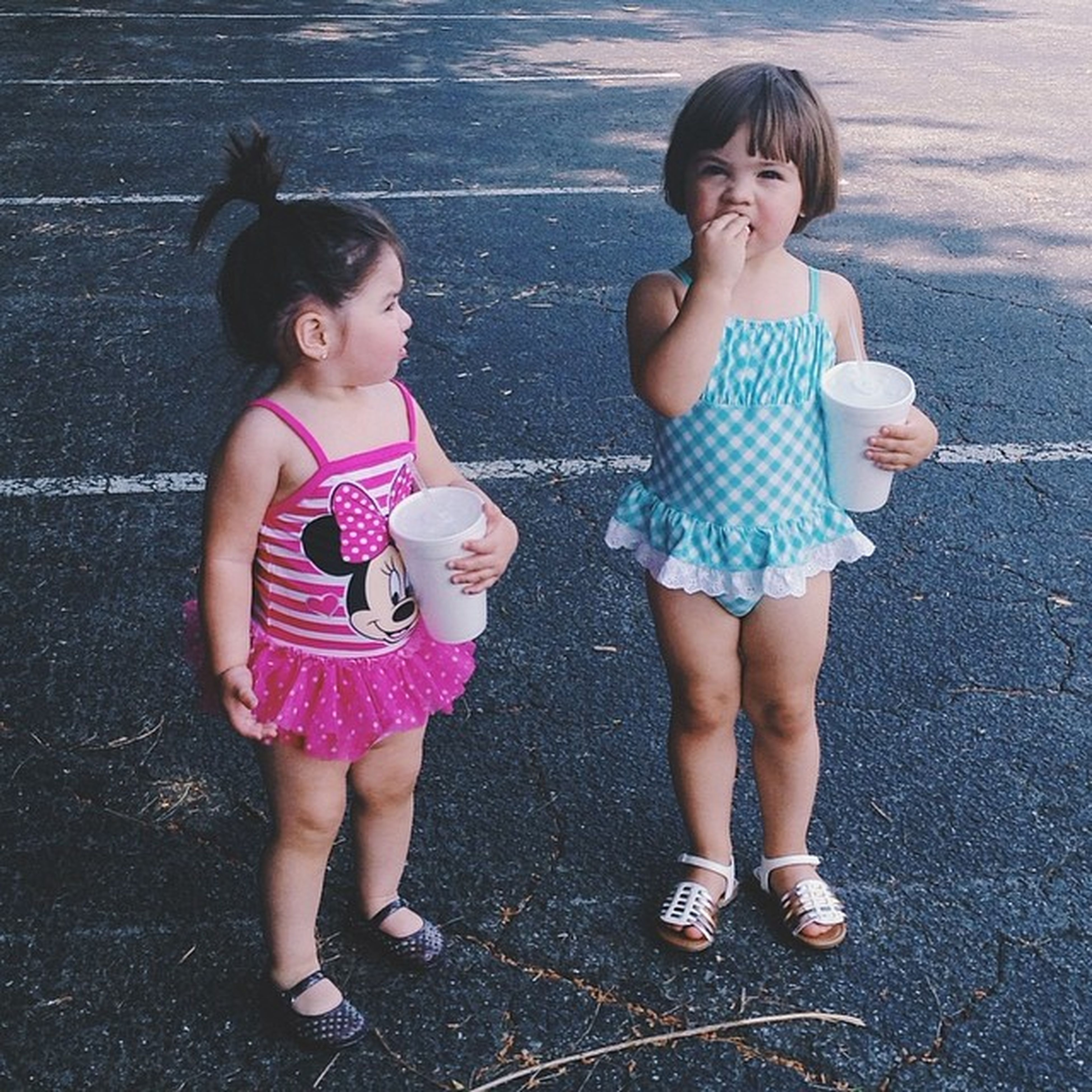 childhood, elementary age, person, full length, girls, cute, casual clothing, lifestyles, innocence, boys, happiness, leisure activity, front view, portrait, looking at camera, togetherness, smiling, standing
