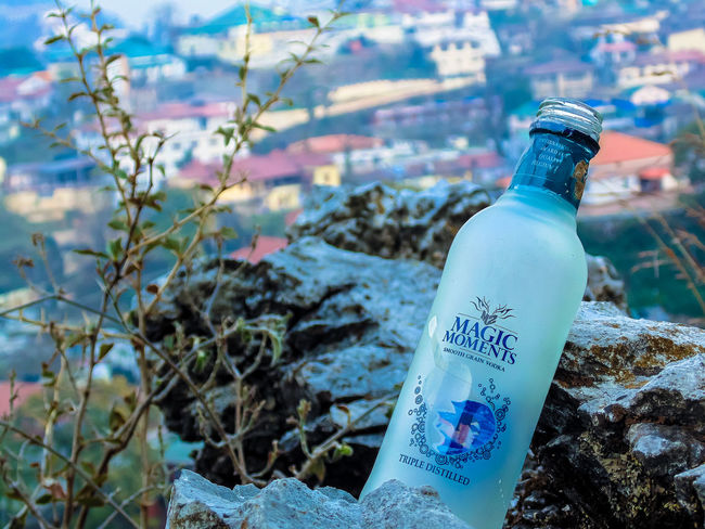 My favourite vodka 😍 magic moments 😍😍 Vodka🍹 Magic Moments Alcohol Bottle Product Photography Hilltop Selective Focus Depth Of Field Rock Tadaa Community Mussoorie Uttarakhand Freshness Nature Town Trip Travel Trekking Adventure Exploring Thrown Away Tourism Beauty In Nature Nature_collection North India