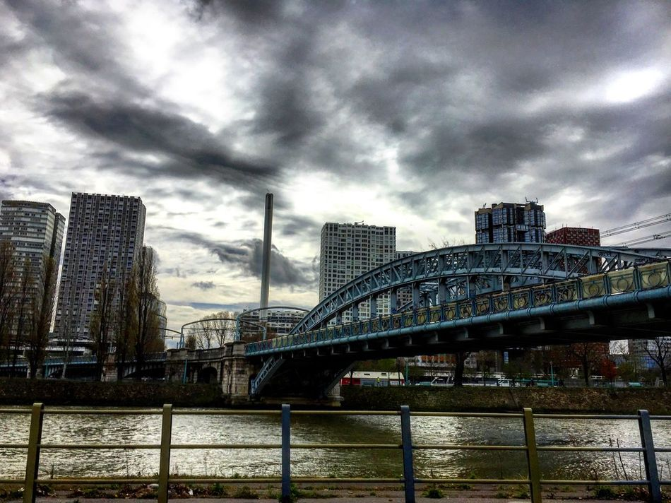 Paris Quay Bridge Buildings Building Exterior Cityscape City View  Urbanphotography Cloudy Day Light And Shadow Seine Seine River Banks Water Shittyweather Mmaff From My Point Of View Eye4photography  EyeEm Gallery Taking Photos Hello World Showcase April