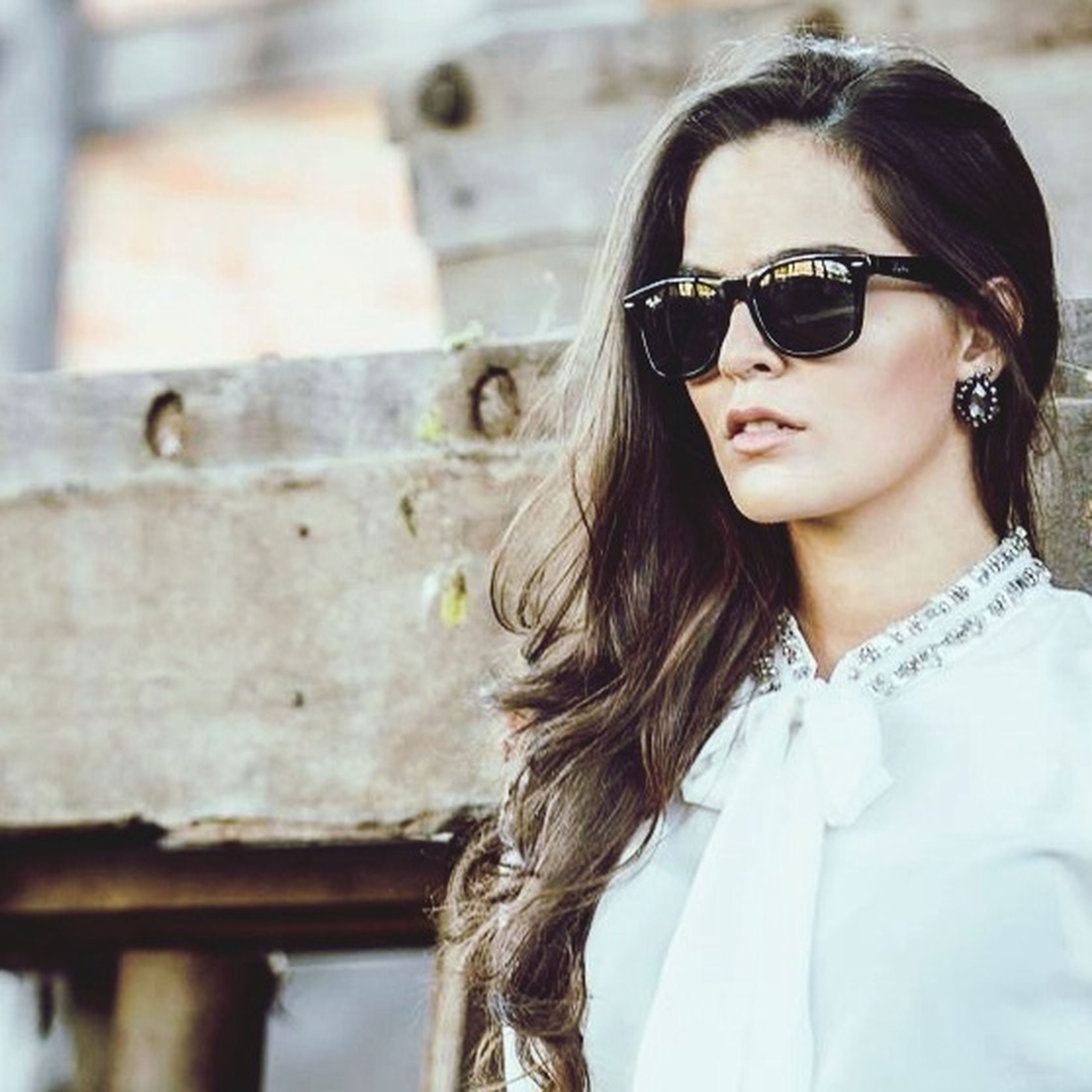 young adult, young women, lifestyles, person, leisure activity, long hair, focus on foreground, headshot, portrait, front view, looking at camera, casual clothing, sunglasses, smiling, waist up, black hair, close-up