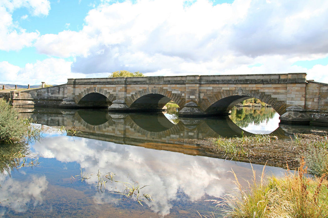 Ross Bridge Tasmania, Australia Reflection Cloud - Sky Water Sky Travel Destinations Bridge - Man Made Structure Outdoors Architecture Waterfront River No People Vacations Scenics Tranquil Scene Tasmanian Landscape Tourism Australian Landscape Beauty In Nature History Built Structure Architecture Landscape Horizon Over Water