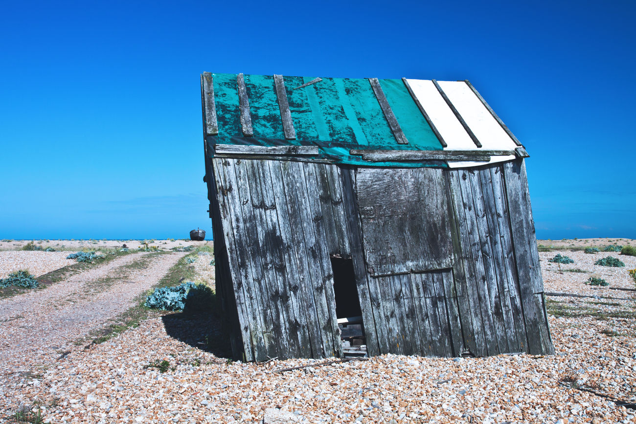 Shack on Dungeness beach, England Beauty In Nature Blue Clear Sky Coast Day Dungeness England Outdoors Sea Shack Sky Slanted
