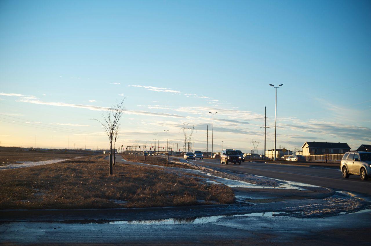 Fargo, North Dakota / February 19, 2016 Alternative Energy Cloud Connection Distant Dusk Environmental Conservation Fargo Fuel And Power Generation Journey North Dakota Outdoors Pole Road Sky South Fargo Street Light The Way Forward Transportation Wind Power Wind Turbine