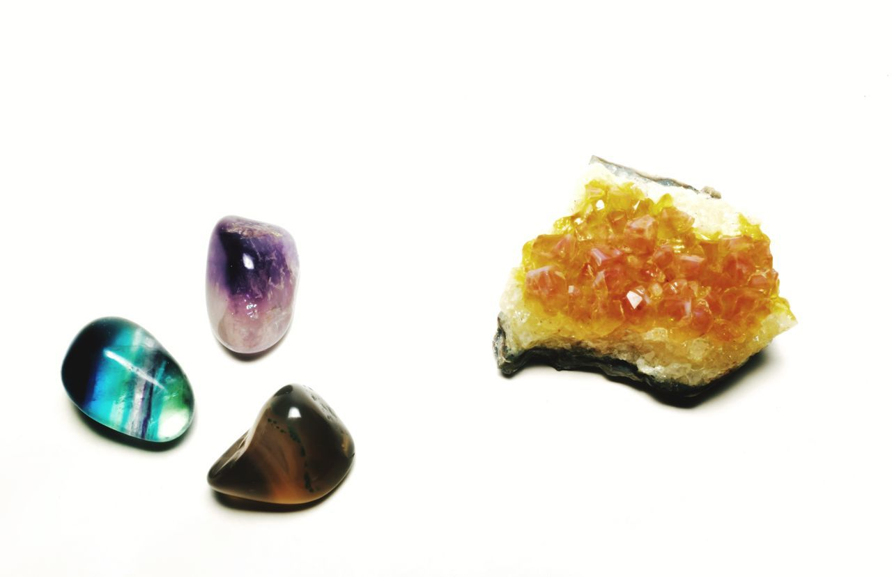 An assortment of gemstones and geodes in various forms arranged on a white background. Crystal Beauty Beauty In Nature Synergy Collection Vibrant Color Vivid Vivid Colours  MidWest Orange Stone Stone Material Spirituality Spiritual Balance Luck Lucky Healing Gemstones Citrine Amethyst Tigereye White Background No People Close-up Day