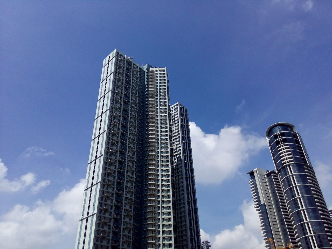 skyscraper, low angle view, sky, modern, architecture, city, no people, outdoors, day