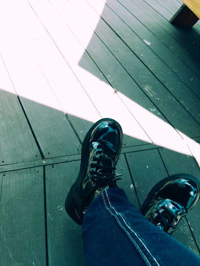 Shoe Jeans Footwear Denim Combat Boots Wood Paneling Low Section Personal Perspective Person Low Section Shoe Personal Perspective Men High Angle View Human Foot Jeans Footpath Footwear Canvas Shoe Directly Above Sitting Casual Clothing Denim Relaxation Flooring