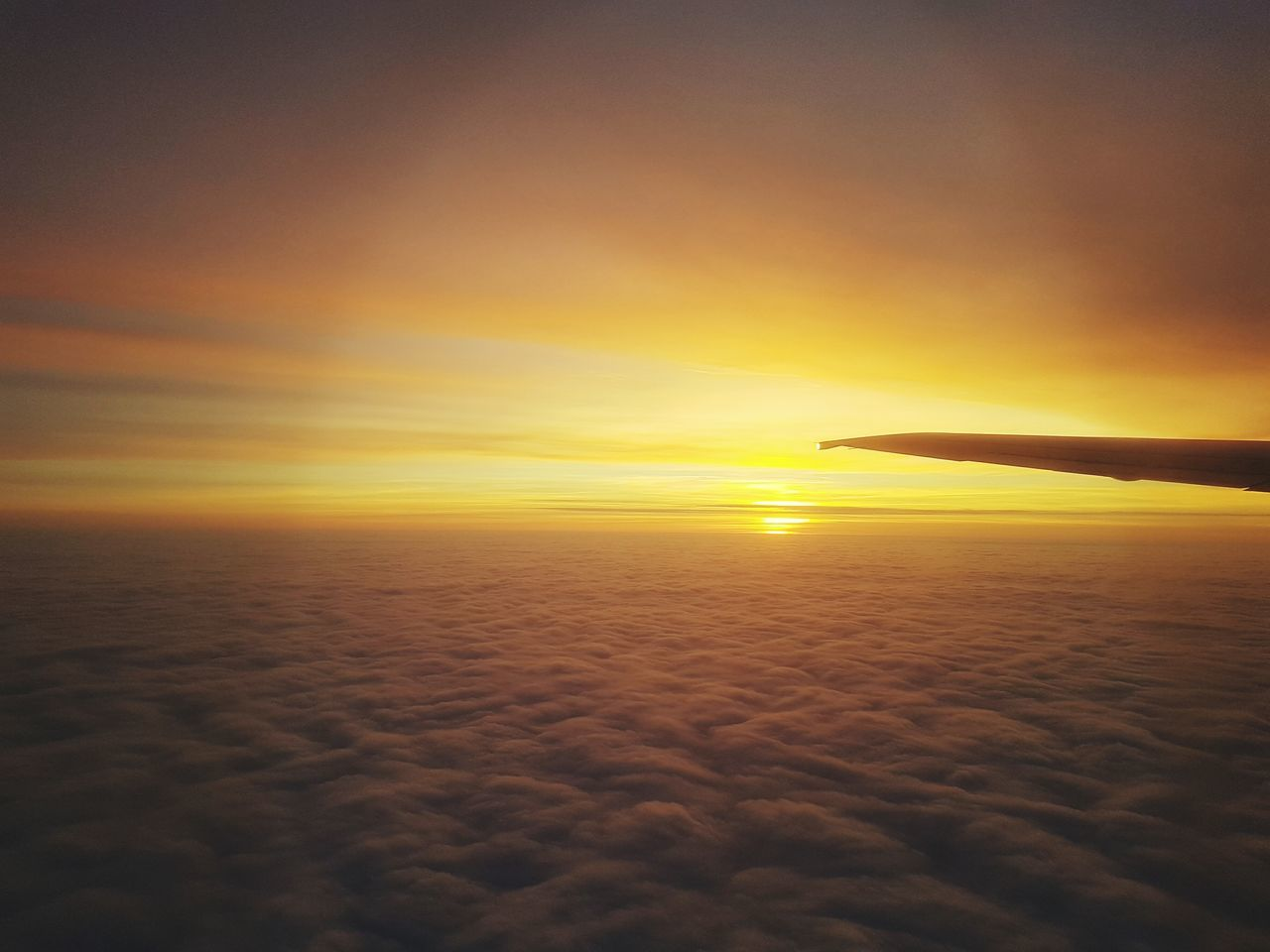sunset, sky, transportation, beauty in nature, airplane, nature, cloud - sky, scenics, orange color, mode of transport, journey, tranquil scene, air vehicle, travel, flying, tranquility, outdoors, aircraft wing, airplane wing, no people, sun, silhouette, water, day