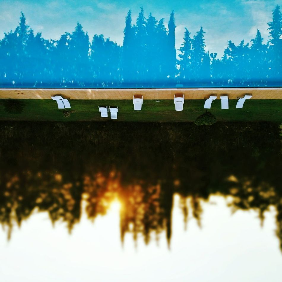 Riflessi||isselfiR Water Reflection Tranquility Sky Blue Outdoors Standing Water No People Low Angle View BestofEyeEm FreshonEyeem Poollife Pool Poolview Sunset Tramonti_italiani Sunset Silhouettes Suns