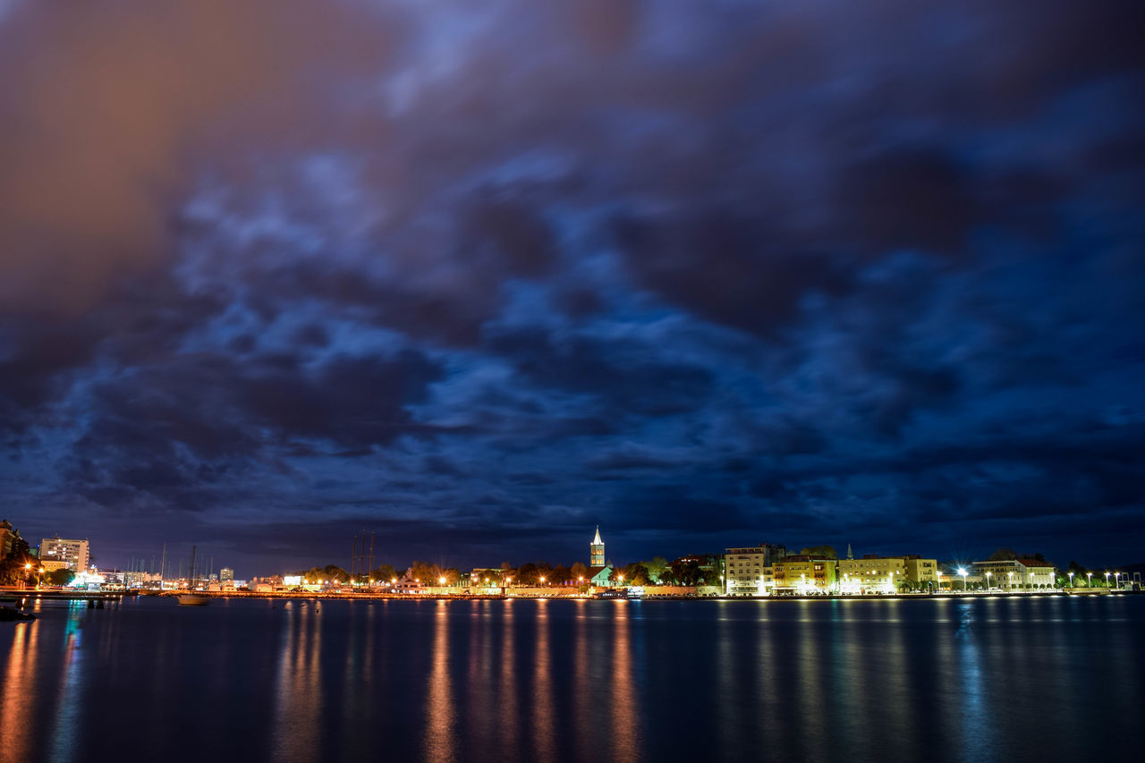 Architecture Building Exterior Built Structure City Cityscape Cloud - Sky Illuminated Long Exposure Nature Night No People Outdoors Reflection Sea Sky Skyscraper Storm Cloud Thunderstorm Urban Skyline Water Waterfront