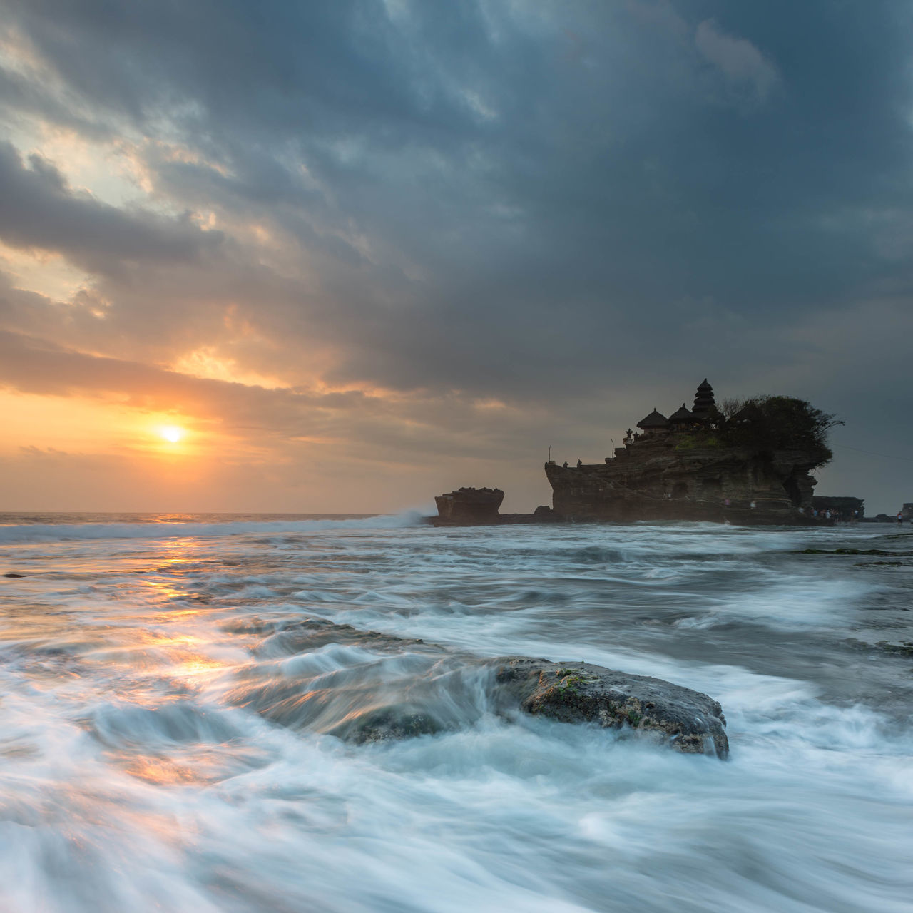 Sunset at Tanah Lot, a popular tourist attraction in Bali, Indonesia. Architecture Bali Beach Cloud - Sky Clouds Clouds And Sky Cloudscape INDONESIA Island Moss Nature Outdoors Pura Rock Formation Romantic Sky Sea Sunset Sunsets Tanah Lot Temple Tourist Tourist Attraction  Travel Destinations Wave Waves