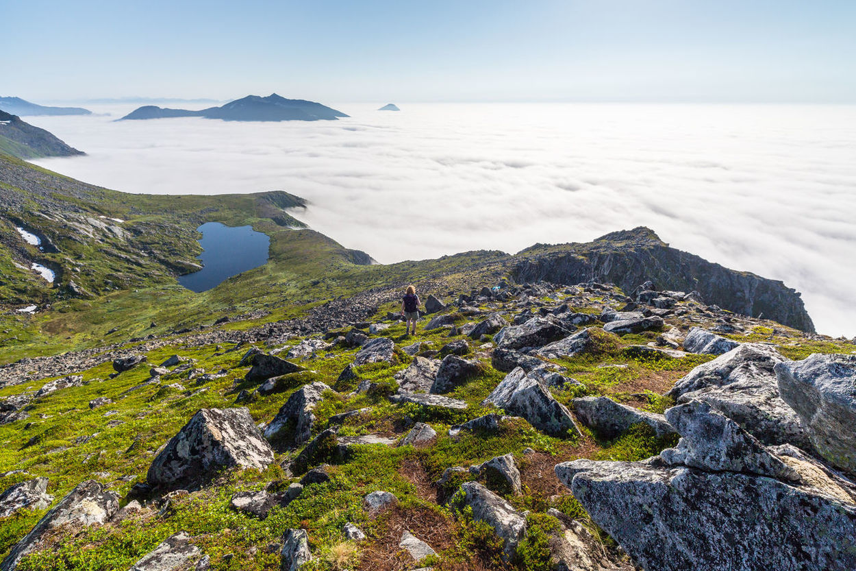 Above The Clouds Beauty In Nature Blue Calm Clouchasing Coastline Day Hiking Idyllic Landscape Mountain Nature Northern Norway Norway Ocean Outdoors Remote Rock Rock - Object Rock Formation Scenics Sea Sky Tranquility Wanderlust