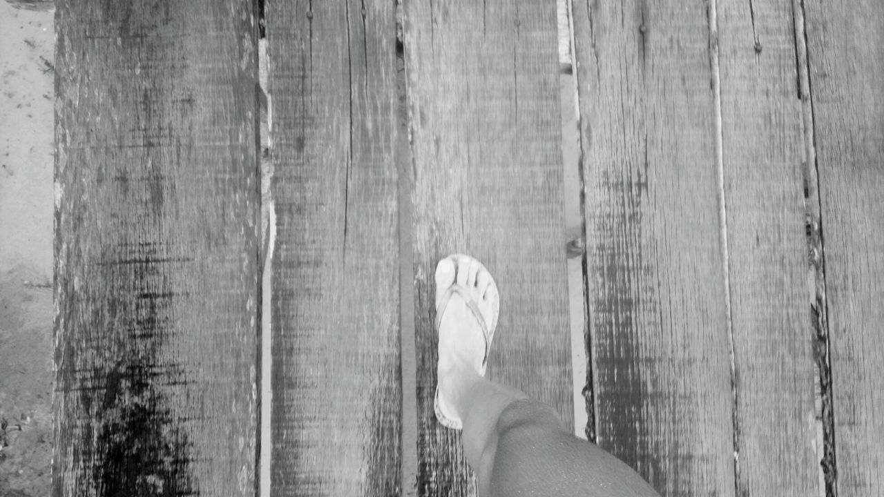 low section, human leg, human foot, human body part, limb, wood - material, barefoot, personal perspective, one person, real people, day, hardwood floor, outdoors, wood paneling, close-up, lifestyles, adult, people, adults only, only men