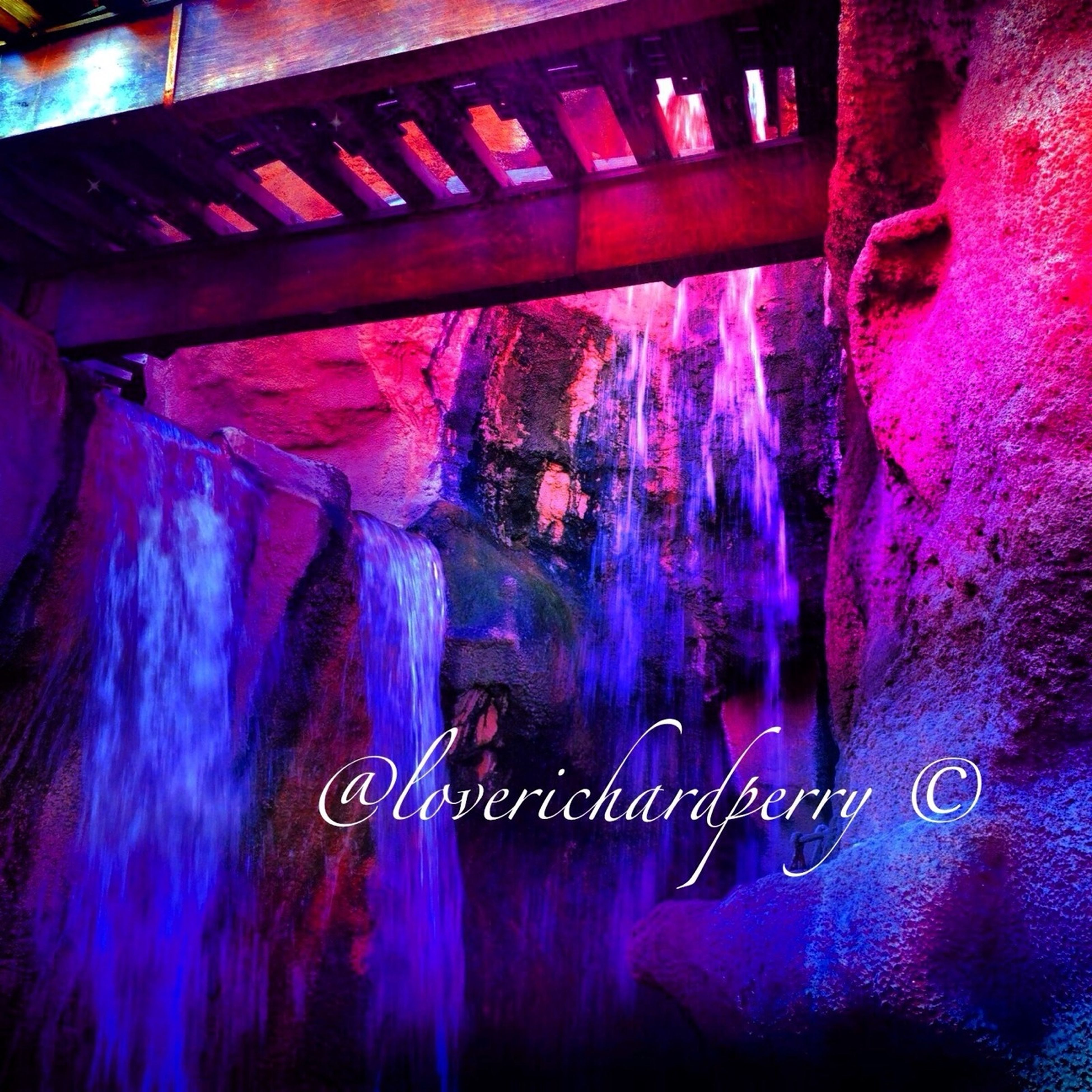 indoors, illuminated, wall - building feature, light - natural phenomenon, built structure, no people, night, reflection, abandoned, high angle view, close-up, lighting equipment, arts culture and entertainment, blue, architecture, wall, multi colored, hanging, graffiti, old