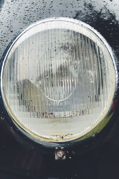 Head light Transportation Land Vehicle Close-up Water No People Mode Of Transport Wet Car Outdoors Day Motorcycle Tire Head Light Light Raindrops Shiny Retro Styled Vintage Cars Vehicles Vintage Style Vehicle Part Vehicle Metal Glass - Material