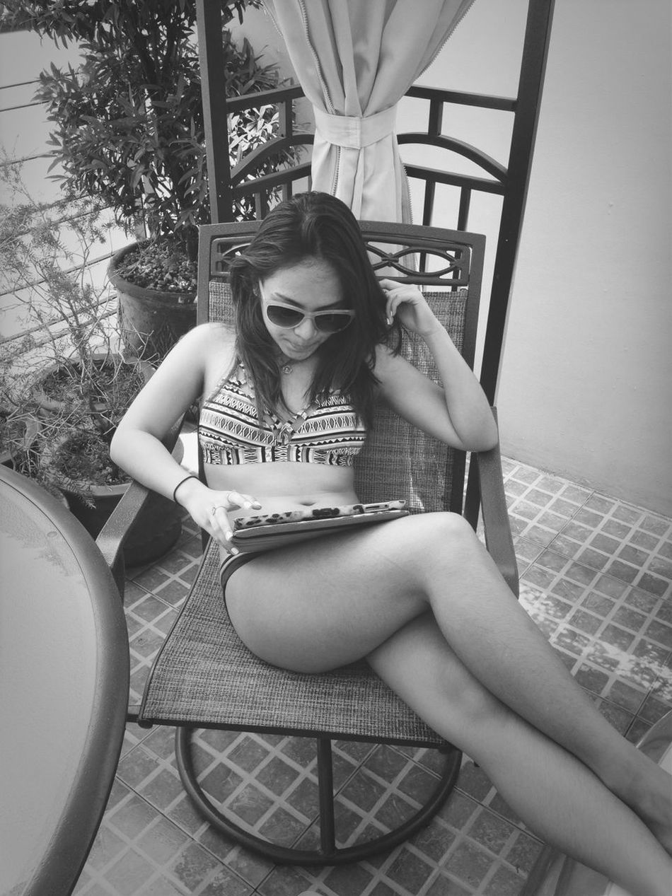 Summer reading by the inflatapool