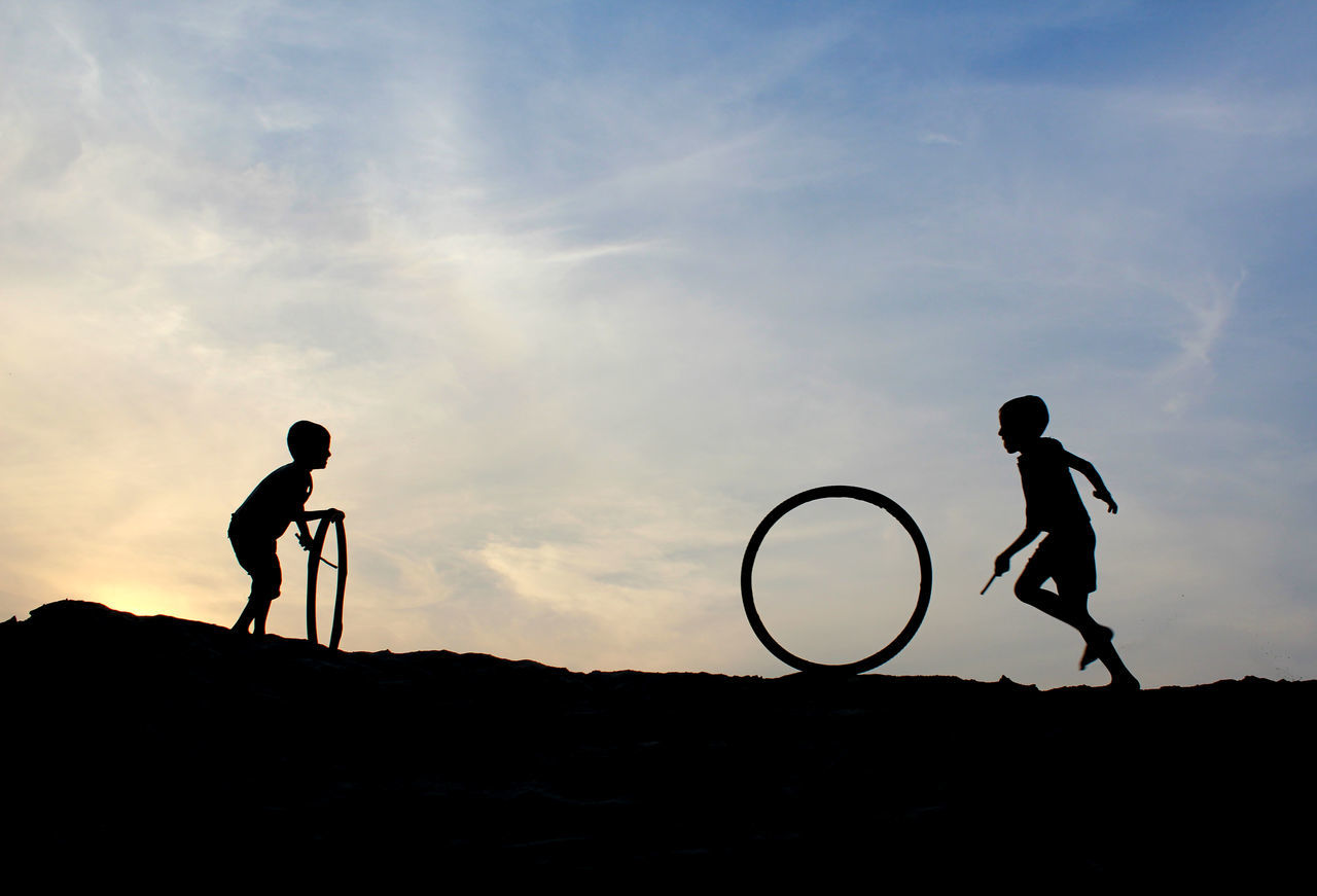 Boys Full Frame Full Length Game Nature Outdoors People Silhouette Sky Two People Tyre