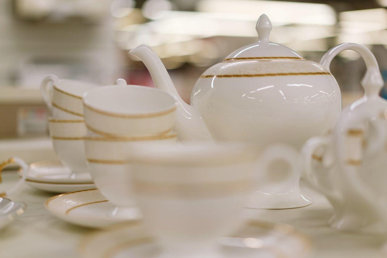 Tea Cup Tea - Hot Drink Afternoon Tea Teapot No People Close-up Indoors  Japanese Tea Cup Store Plate White Color Golden Gold White Shelf Arrangement For Sale Retail  Shopping Shelves Dishes Set Dishes Tea Set Plates Porcelain