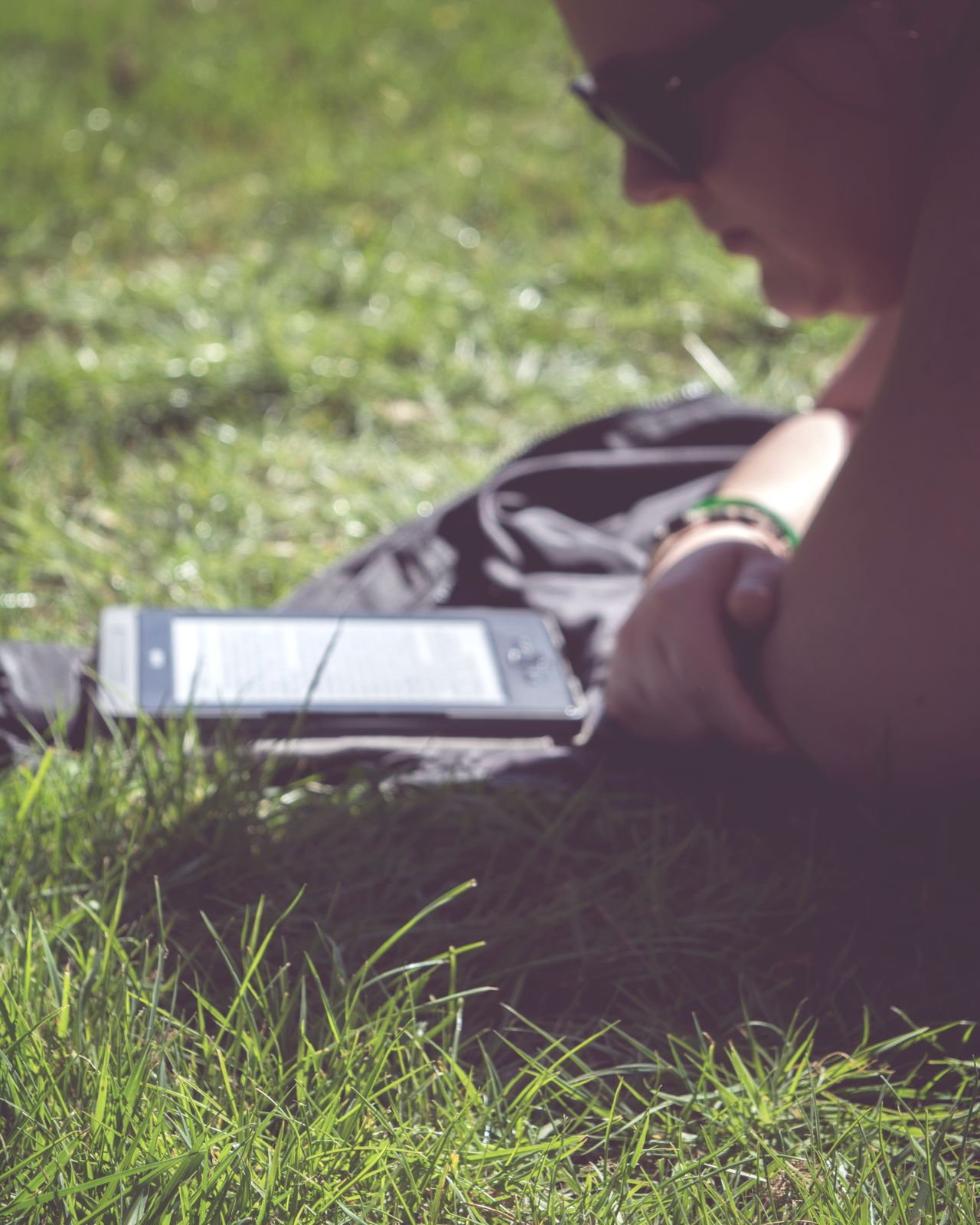 Grass One Person Adult People Outdoors Human Body Part Close-up Reading Ebook Knowledge Inspiring Inspirational Depth Of Beauty Eyeem Market Team Getty+EyeEm Collection Getty Images Gettyimages Environment Real People Depht Of Field Gettyimagesgallery Study Studying Learning Growth