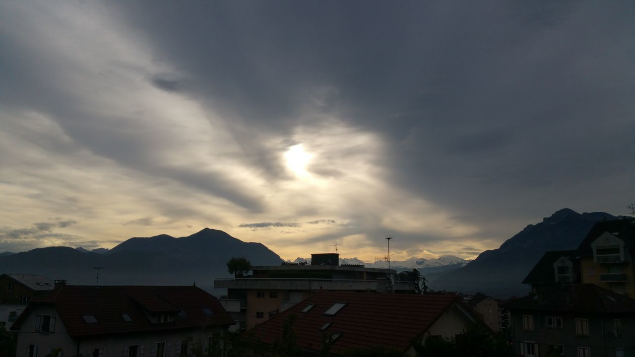 building exterior, architecture, built structure, house, cloud - sky, sky, no people, residential building, town, sunset, city, roof, mountain, outdoors, nature, beauty in nature, cityscape, residential, day