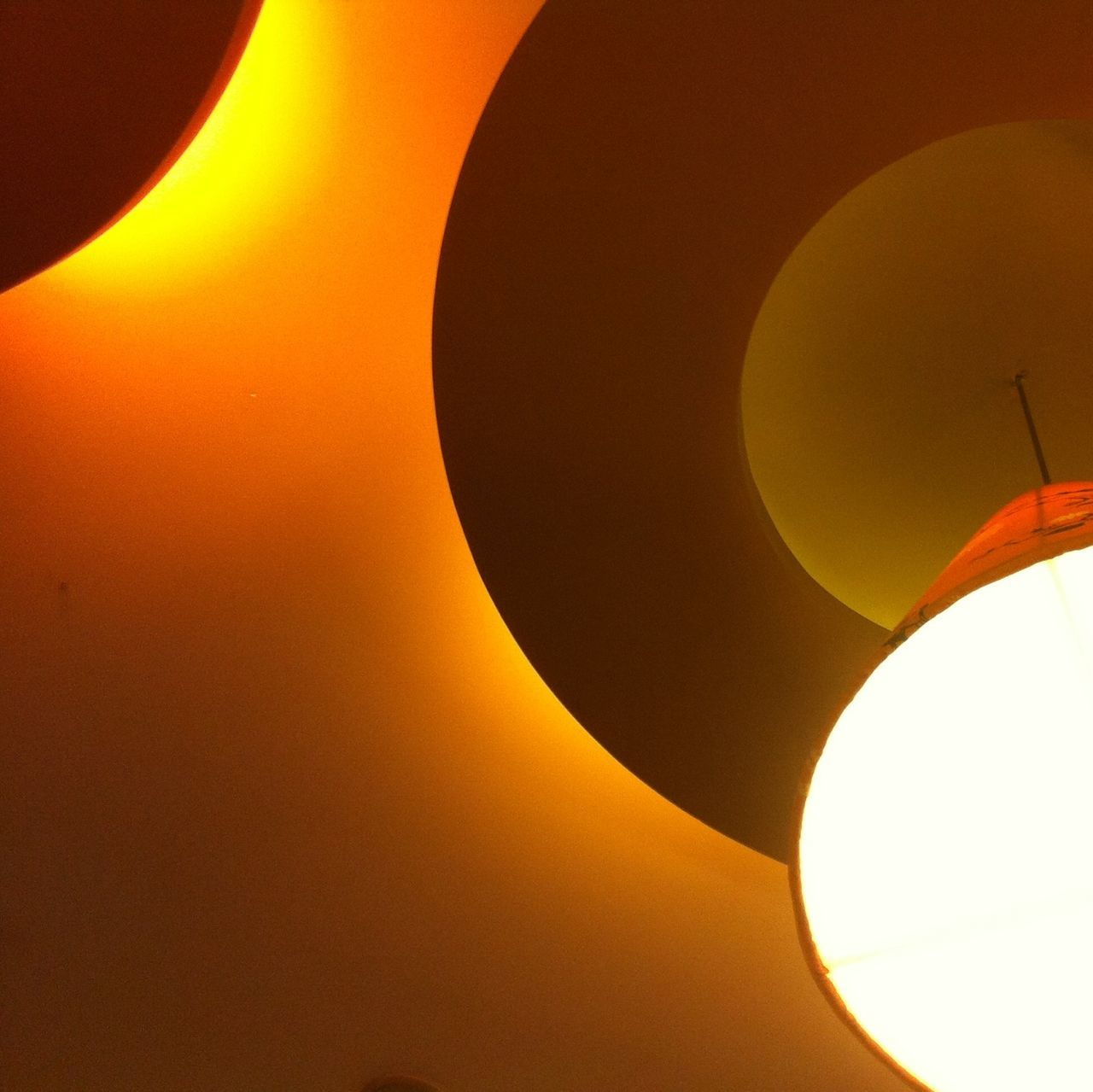 Low Angle View Of Illuminated Electric Lamps At Home