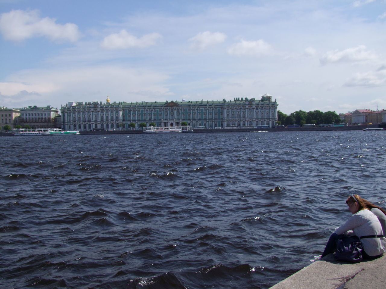Hermitage Museum Across The Water Blue Sky White Clouds Boats Building Exterior Composition Distant View Façade Hermitage Museum History Incidental People Museum Outdoor Photography Ripples In The Water Russia Russian Architecture Saint Petersburg Sea Shoreline Tourist Attraction  Tourist Destination Traditional Architecture Waves